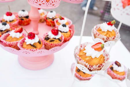 wedding cupcakes in iron baskets