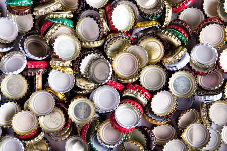 a lot of caps of beer, randomly scattered, background, top view