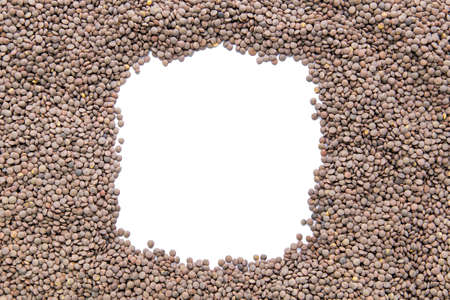 a place for the text: dry raw lentils is scattered in a circle in the center is a place for text