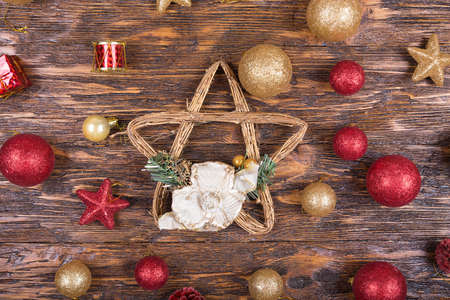 christmas toy: bright Christmas toy on a wooden background. Christmas and New Year, Christmas tree decoration.