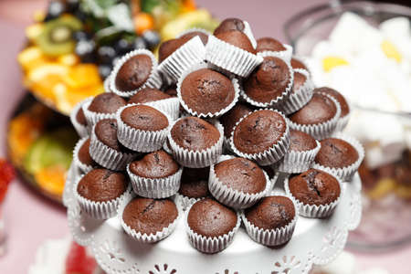 chocolate mini cupcakes on a plate lined with a slide, a holiday Candy Bar