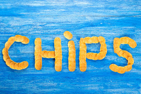 Laid inscription of potato chips - chips. crispy snack to beer