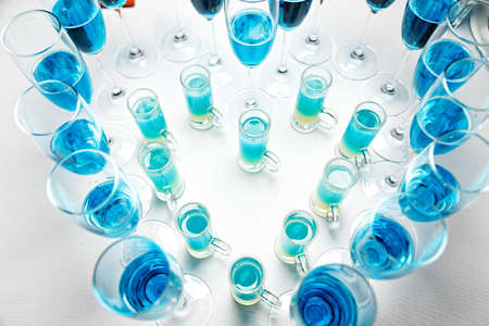 Unusual blue wine champagne in glasses in a restaurant or bar, romantic dinner Stock Photo