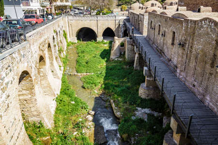 An old quarter with sulfur baths in Tbilisi, a view of the shrunken canal.  April 17, 2015