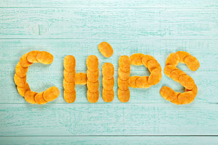 Laid inscription of potato chips - chips. crispy snack to beer. Top view. Stock Photo