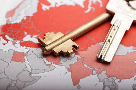 Key on the world map, a symbol open to the world, space for text