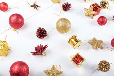 christmas gifts: background for a Christmas card, a set of Christmas toys on the Christmas tree. Stock Photo