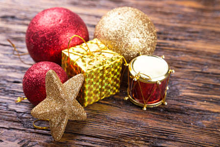 bright Christmas toy on a wooden background. Christmas and New Year, Christmas tree decoration.