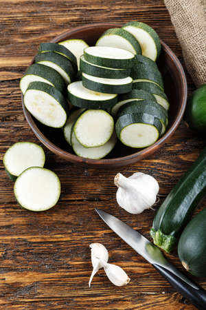 medula: Zucchini sliced and whole zucchini lying on the board. Space for text Foto de archivo