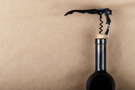 a bottle of wine is opened with a corkscrew, a corkscrew is screwed into a bottle stopper Stok Fotoğraf