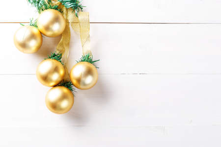 christmas garland with toys gold balls on white background with space for text stock photo