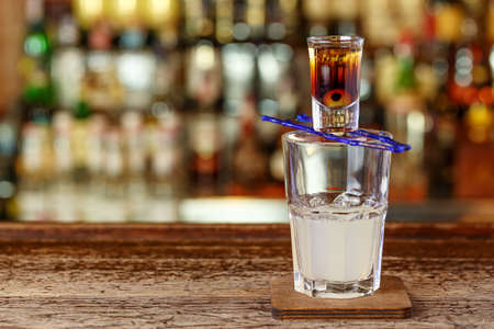 A cocktail with tequila and lemon juice stands on the bar in a restaurant or in a pub. Photo for the menu. Space for text