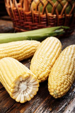 sweet corn on sackcloth, half of corn, some corn peeled, some do not,  closeup 写真素材