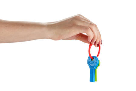 toy car keys in female hand, isolated, on white background