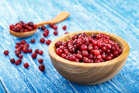 ripe cranberries harvest on a table in a plate. place for text