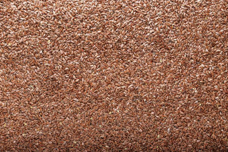 Flax seeds scattered as a background. Place for text