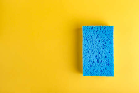 sponge for washing dishes on a yellow background.