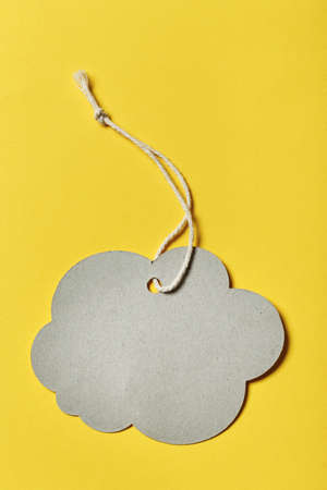 Designer label in the shape of a cloud without an inscription on a yellow background. space for text