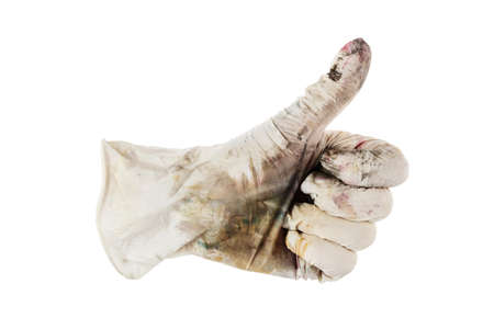 hand in dirty glove shows cool - thumbs up.