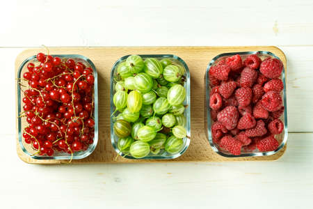 mix of summer berries in glass boxes on the table. space for text 版權商用圖片