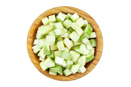 diced zucchini in a plate isolated on white background.