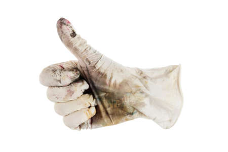 hand in dirty glove shows cool - thumbs up. isolated on white background. 写真素材