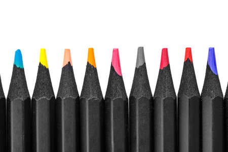 Multi-colored pencils on a white background laid out in a row. isolated