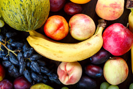 different ripe exotic fruits set. fruits are scattered as a background. summer harvest Imagens