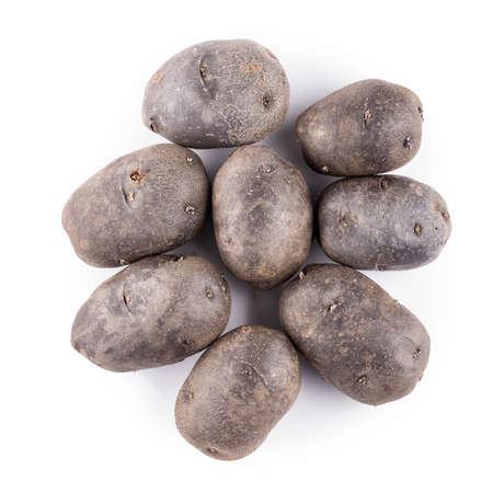 Many purple potatoes isolated on white background. summer harvest
