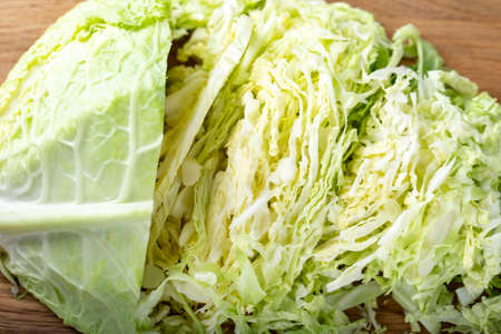 Chopped savoy cabbage on a wooden board. Healthy food Stock Photo