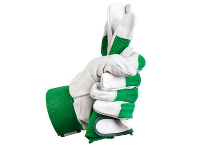 A hand in a working glove holds a second glove. Isolated on white background. place for text.