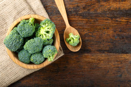 Fresh broccoli cabbage on a brown wooden table in a plate. space for text Imagens - 127574396