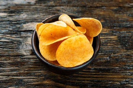 Potato chips is snack in bag ready to eat and fat food or junk food.