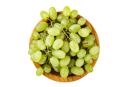 ripe green grapes in a plate isolated on white background. place for text