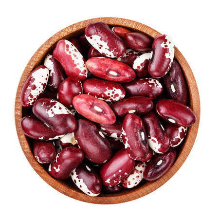 raw beans in a plate. isolated on a white background. file contains clipping path
