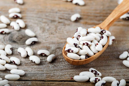white black eyes beans in a wooden spoon on the table. place for text