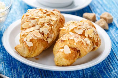 Fresh croissant with coffee on the table. traditional french carbohydrate breakfast  Stock Photo
