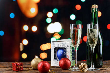 champagne in glasses and in a bottle. romantic christmas background. Nearby lies a Christmas toy. place for text  Stockfoto