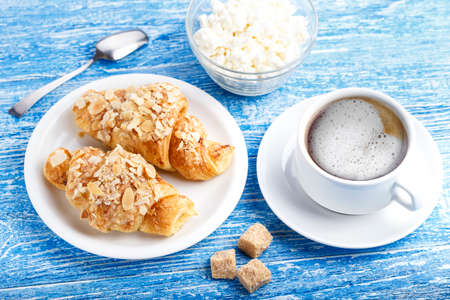 traditional french breakfast. croissant with cottage cheese and coffee