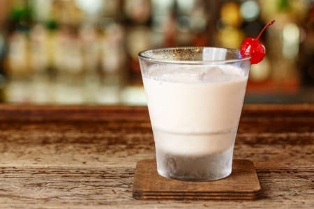 Milkshake with vodka is on the bar in the nightclub. Drinks party.