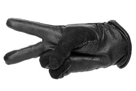 a hand in a black leather glove shows two fingers that mean peace. isolated on white background