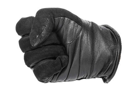 a hand in a black leather glove clenched into a fist. isolated on white background