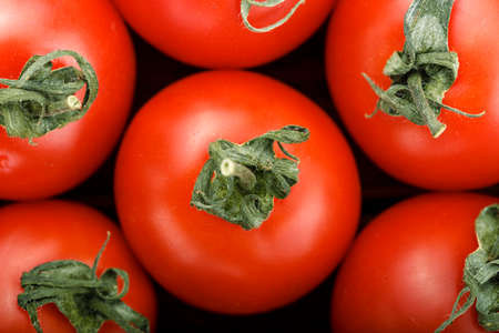 ripe cherry tomatoes are scattered on the table as a background. bright vegetable background, place for text