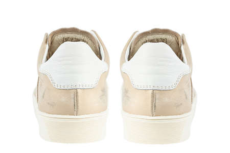 Womens beige sneakers, rear view. isolated on a white background.