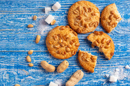 homemade shortbread cookies with peanuts scattered on the table. place for text