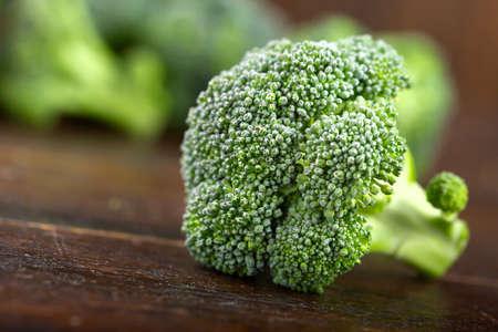 Fresh broccoli on the table surface. Vegetarian food.