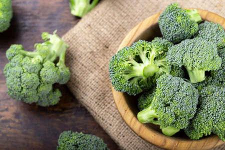 Fresh raw broccoli in a wooden bowl. Vegetarian food. Reklamní fotografie