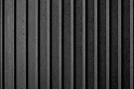 ribbed surface of the grill pan. cast iron texture is clearly visible. place for text