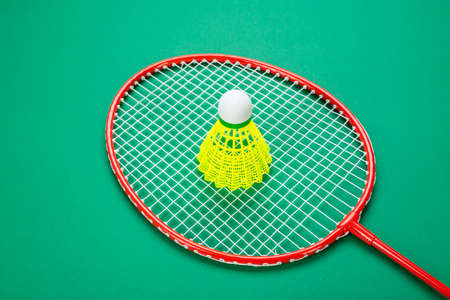 Shuttlecock and badminton racket. on a green background. Concept summer relaxation.