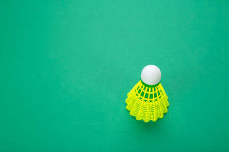 Badminton shuttlecock on a green background top view. The concept of active breathing. Stock Photo
